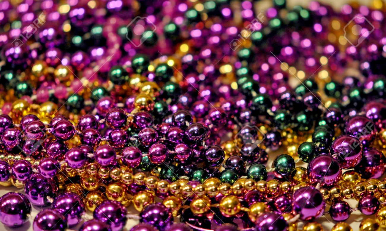 Background Of Mardi Gras Beads With Shallow DOF Stock Photo 1300x780