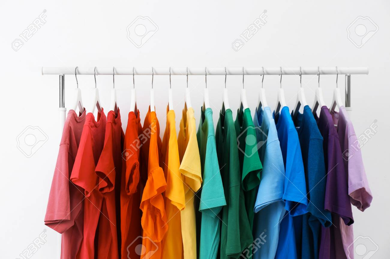 Rack With Bright Clothes On White Background Rainbow Colors Stock 1300x866