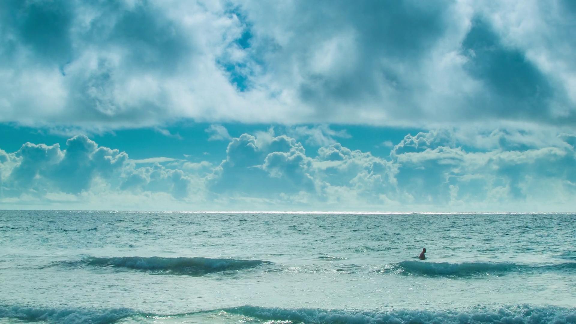 Man Swimming Alone in a Vast Ocean in the Bermuda Triangle in 1920x1080