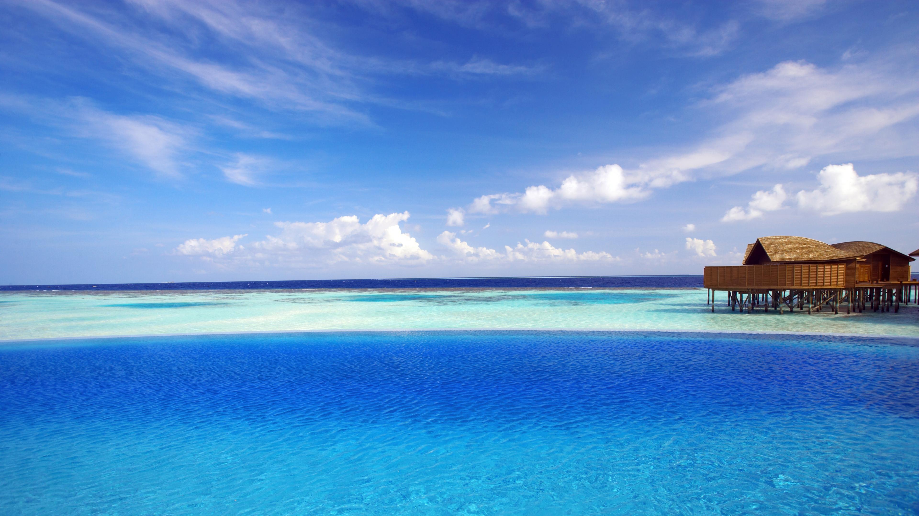 Download Wallpaper 3840x2160 maldives tropical bungalows ocean 4K 3840x2160