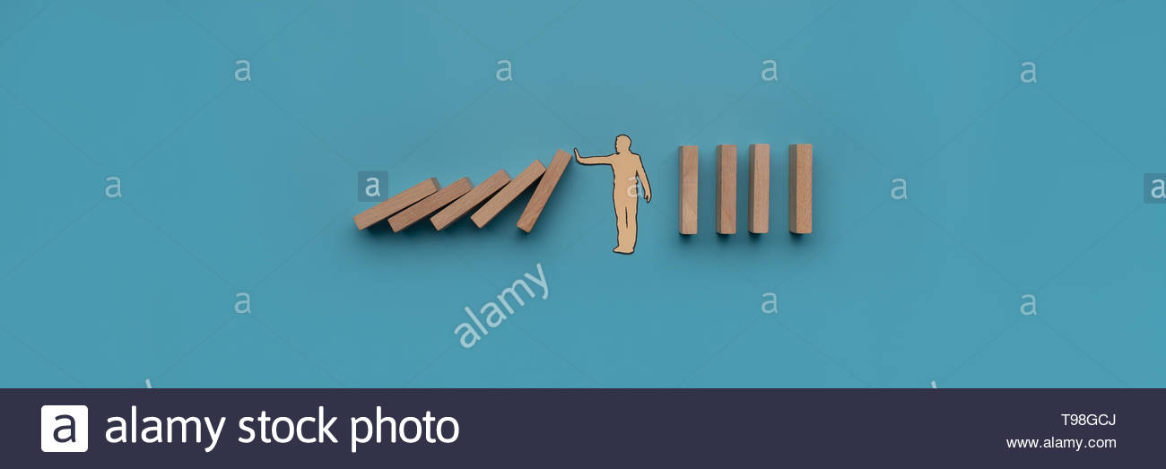 Paper cut silhouette of a paper man stopping dominos from falling 1300x523