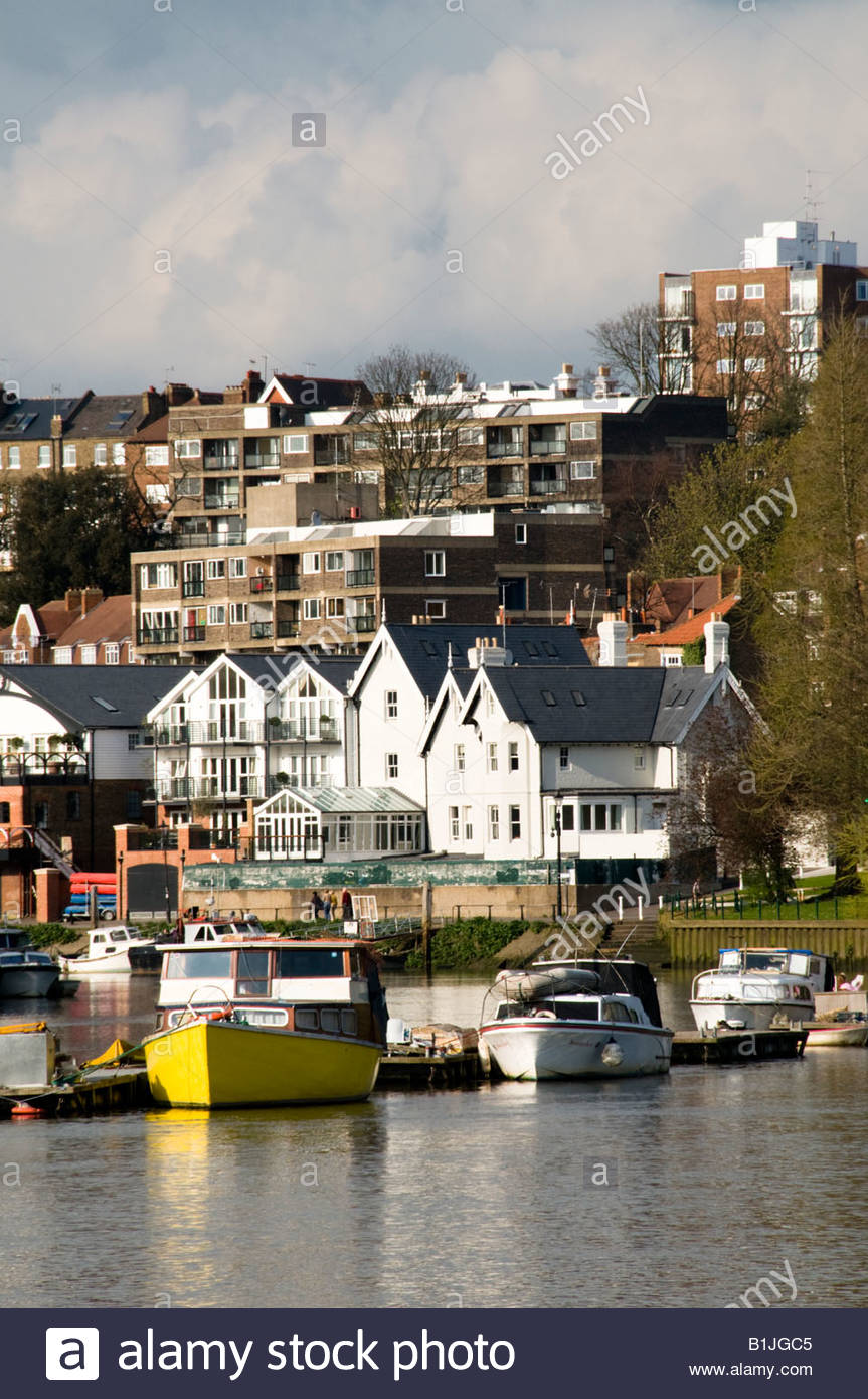 Boats on River Thames with houses and flats in the background 863x1390