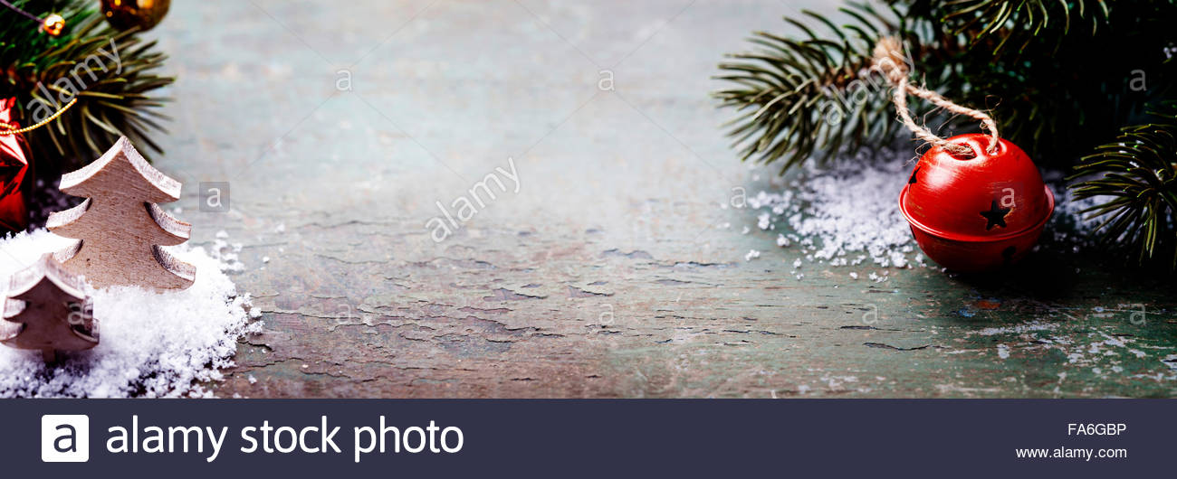 Christmas Jingle bells on a rustic wooden background Stock Photo 1300x530