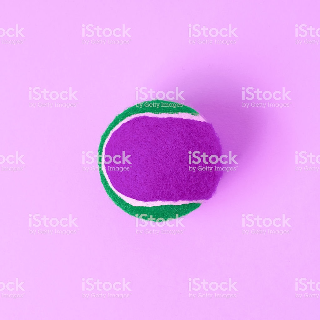 Purp E Green Tennis Ball On Pink Background Stock Photo   Download 1024x1024