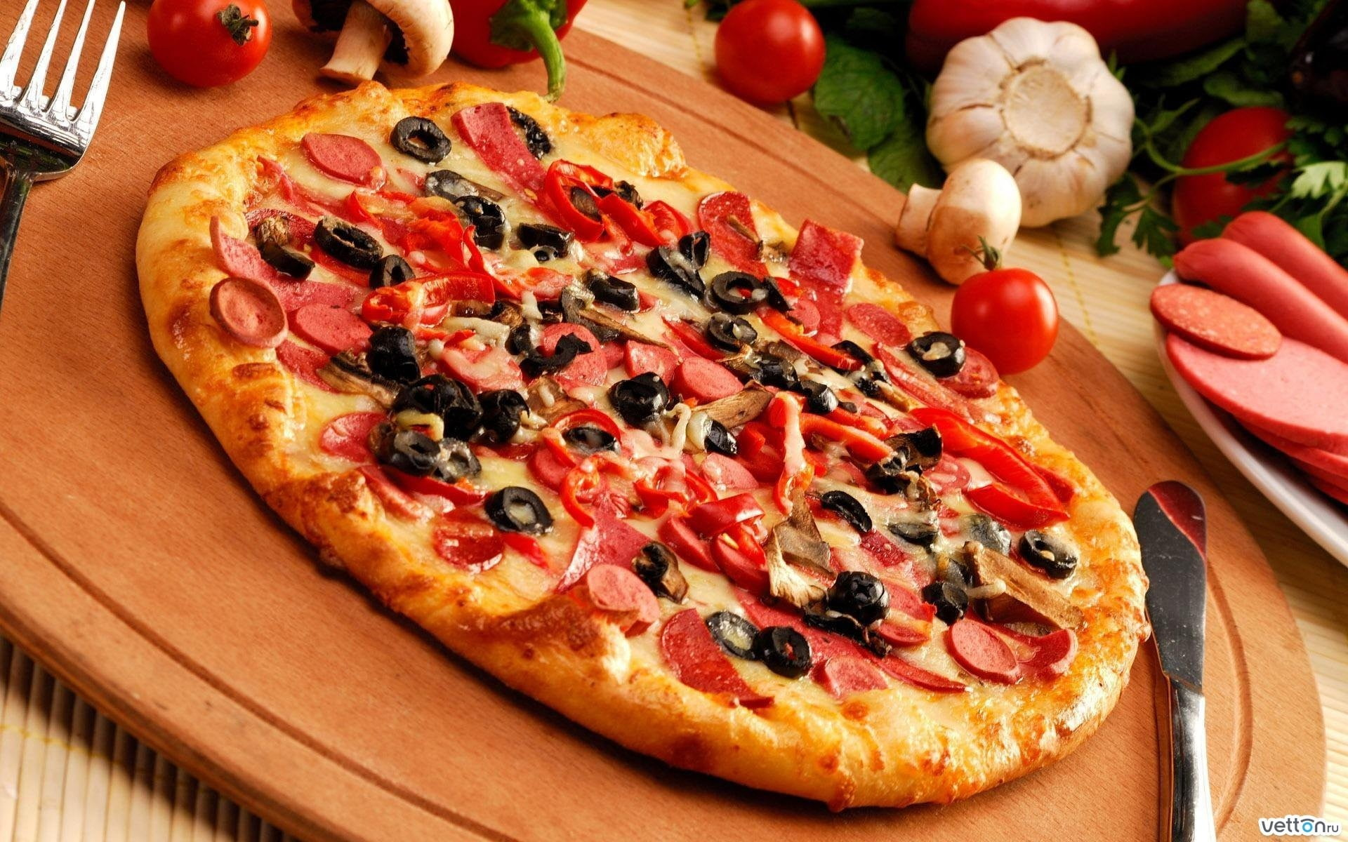 Pepperoni with black olive pizza on brown wooden tray with knife 1920x1200