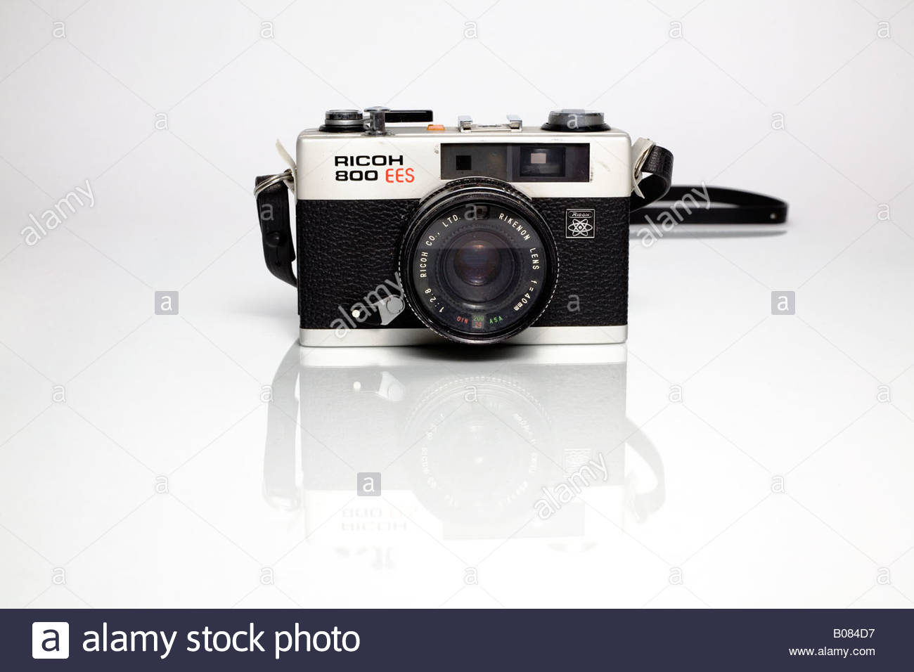 Ricoh 800 Vintage Film Camera with Strap on White Background Stock 1300x956