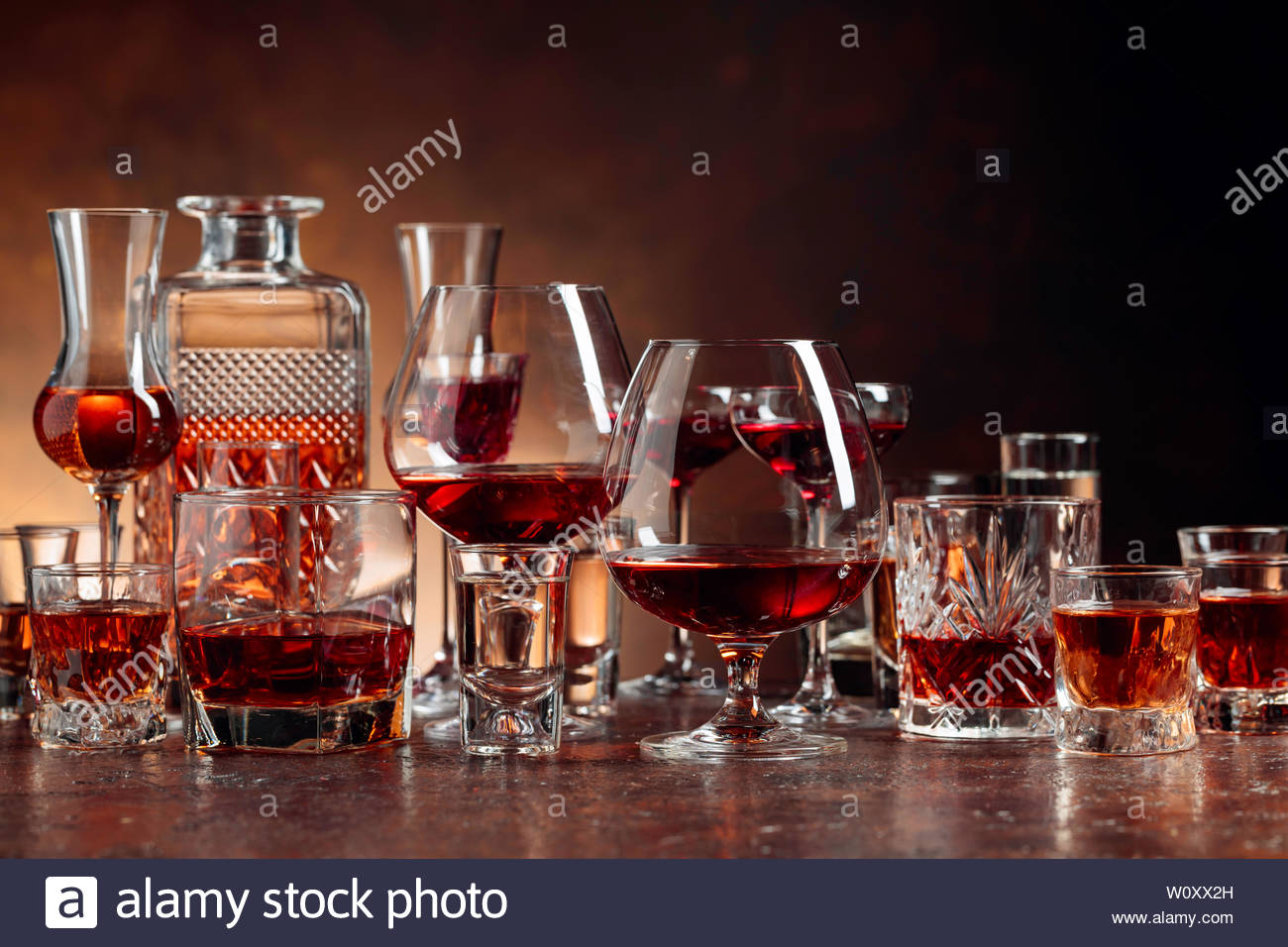 Set of strong alcoholic beverages in glasses on a brown background 1300x956