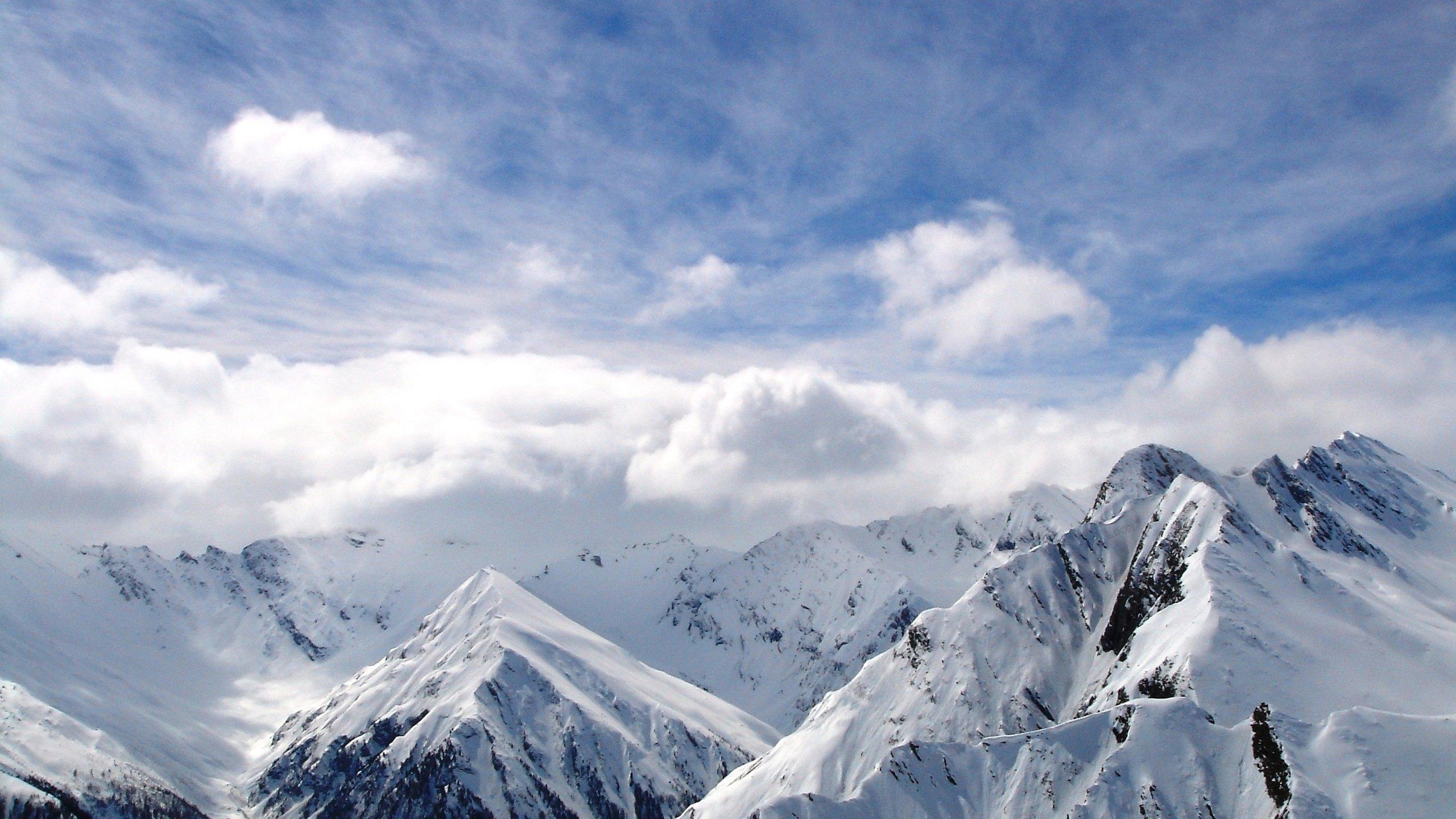 Mountains winter snow clouds white sky wallpaper 2560x1440 2560x1440