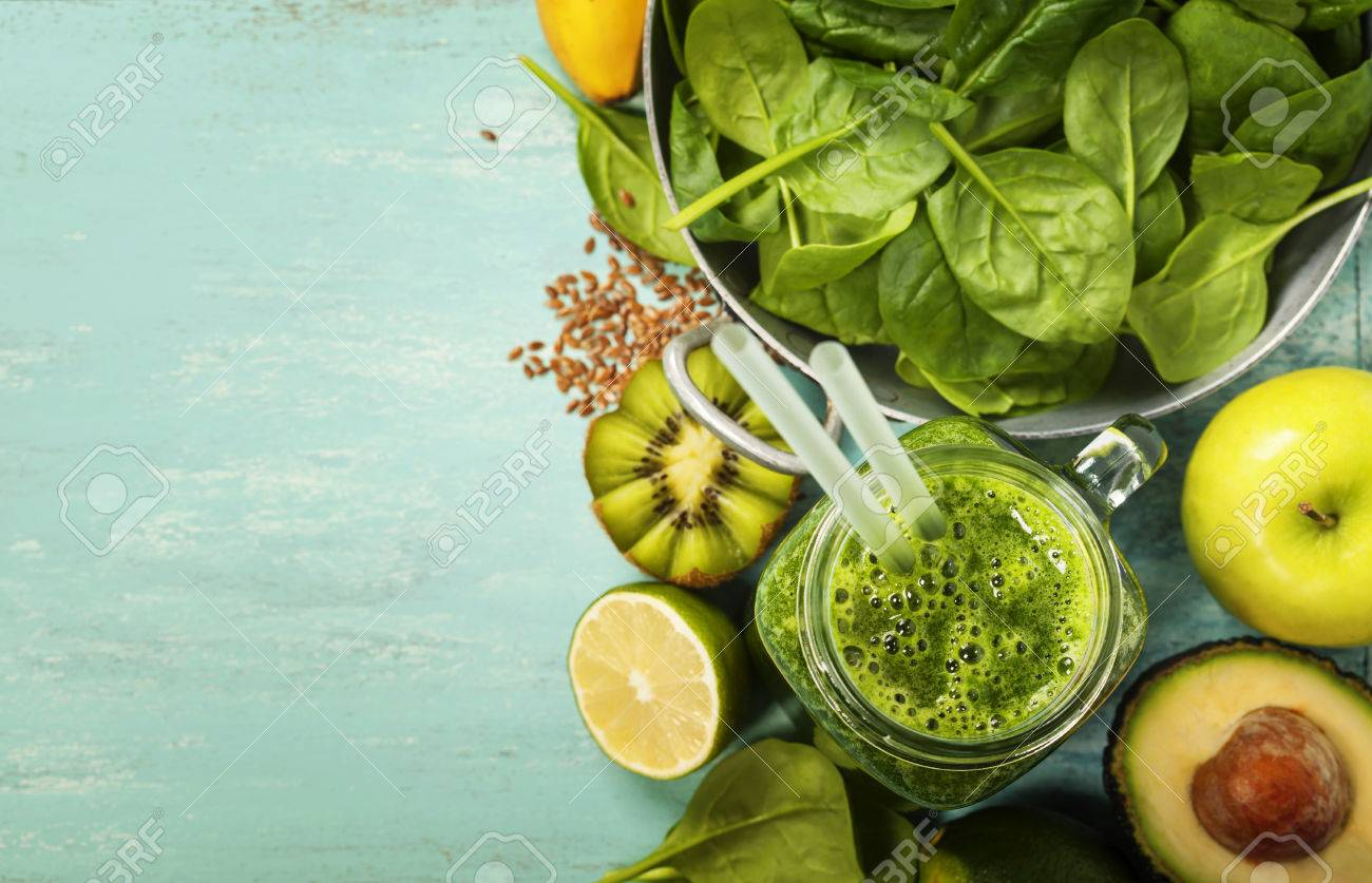 Healthy Green Smoothie And Ingredients On Blue Background 1300x837
