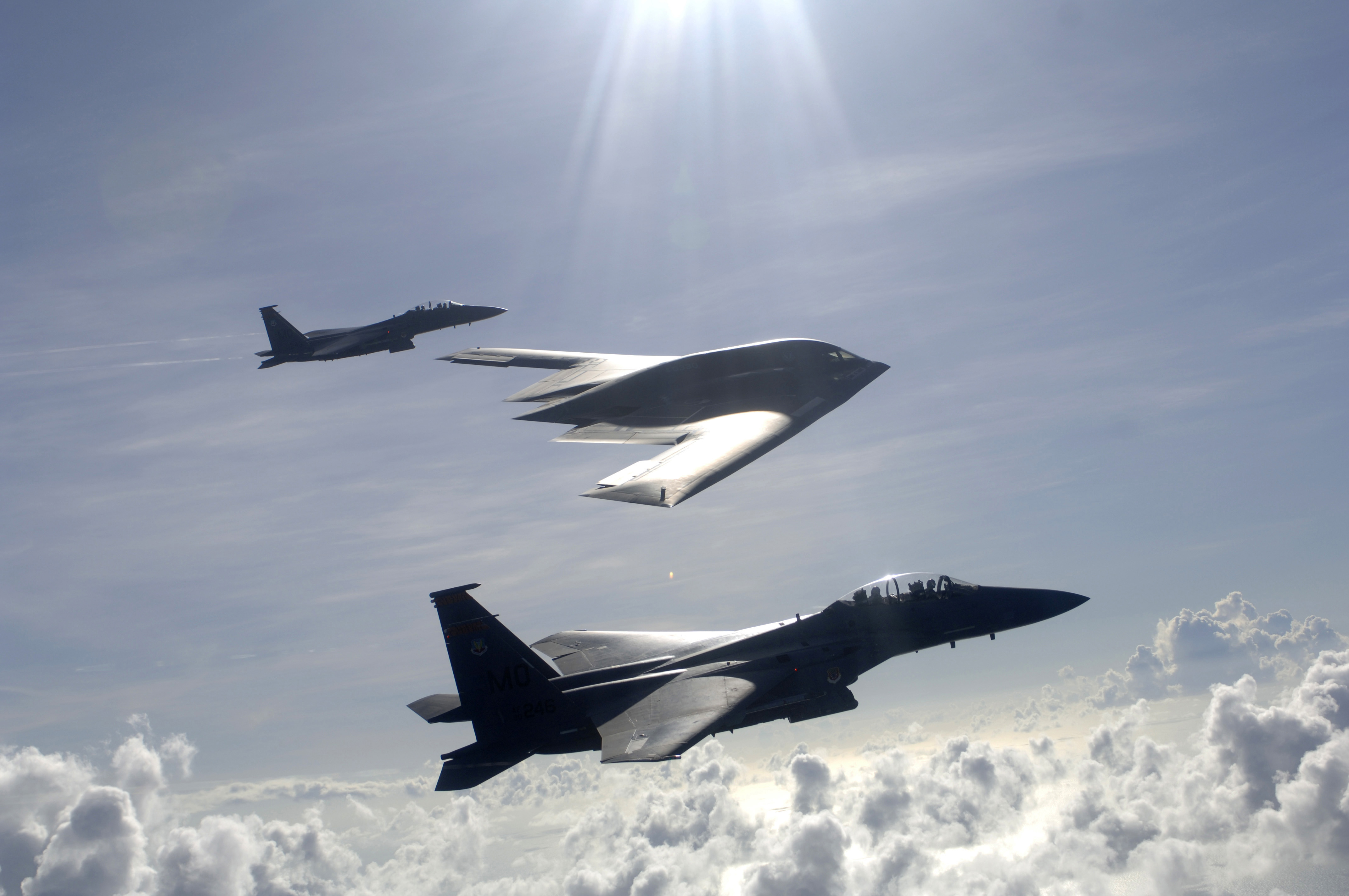 Force F 15E Strike Eagles and a B 2 Spirit bomber fly in formation 4288x2848