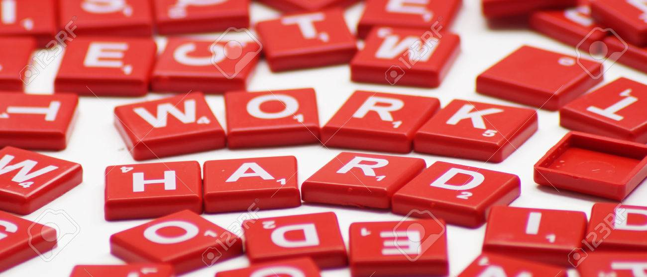 Work Hard Word With Crossword Background Stock Photo Picture And 1300x558