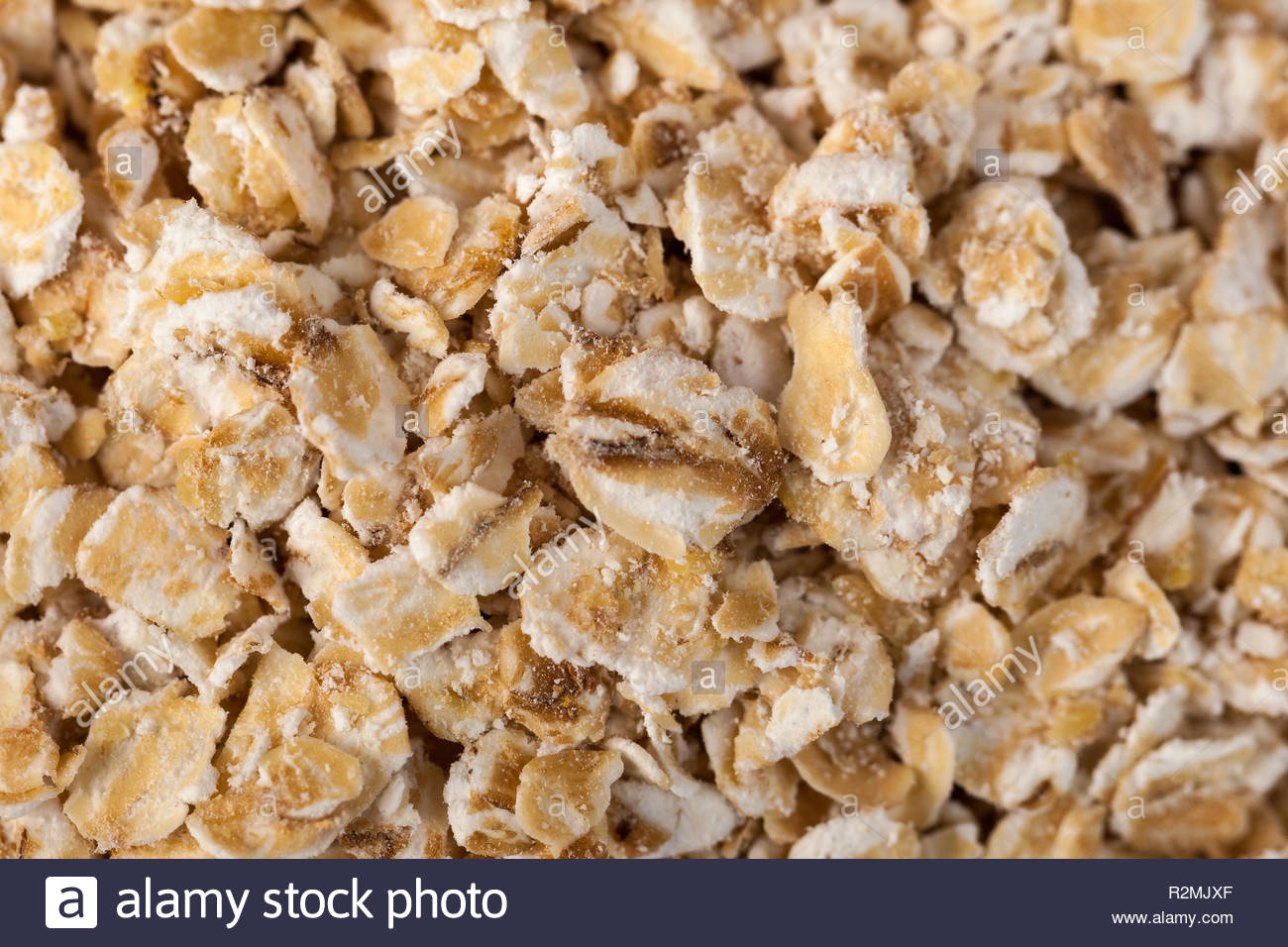 Rolled oats background Organic oatmeal background texture macro 1300x956
