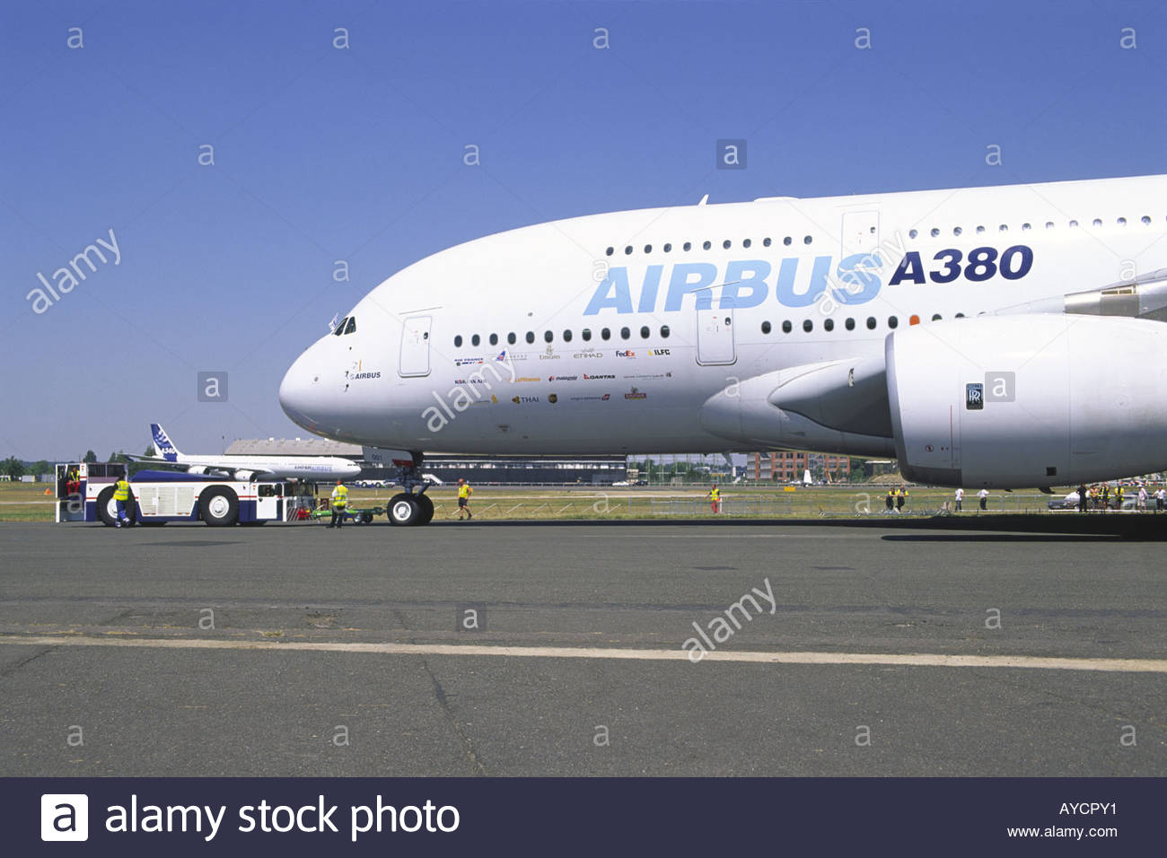 Airbus A380 aircraft tug with Airbus A340  600 in background at 1300x956