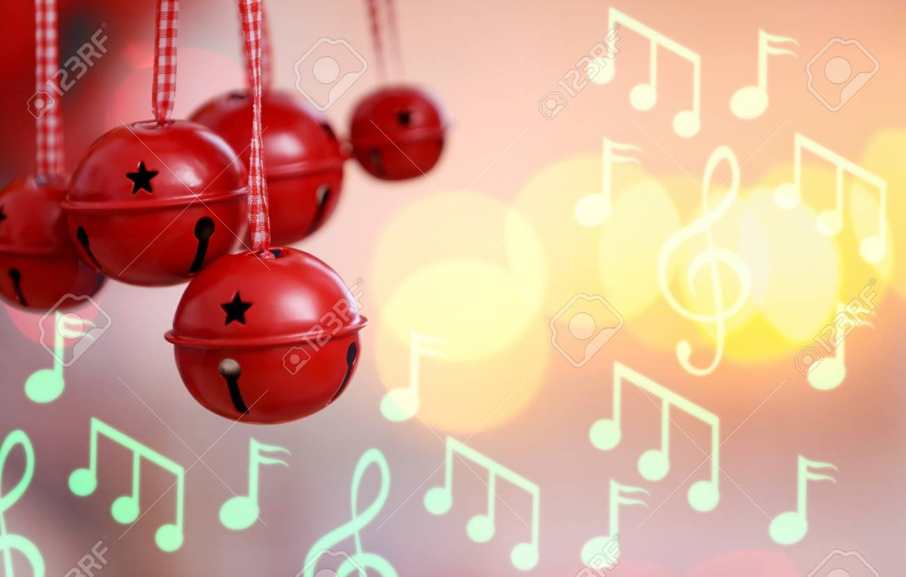 Jingle Bells And Notes On Blurred Lights Background Concept 1300x828