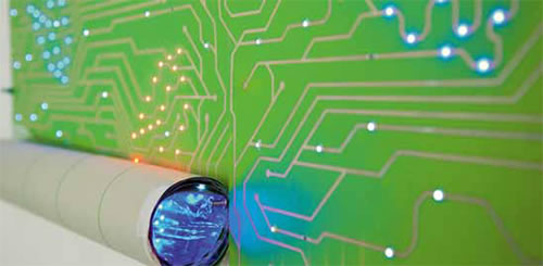 an LED lit wallpaper panels that looks like giant circuit boards 500x245