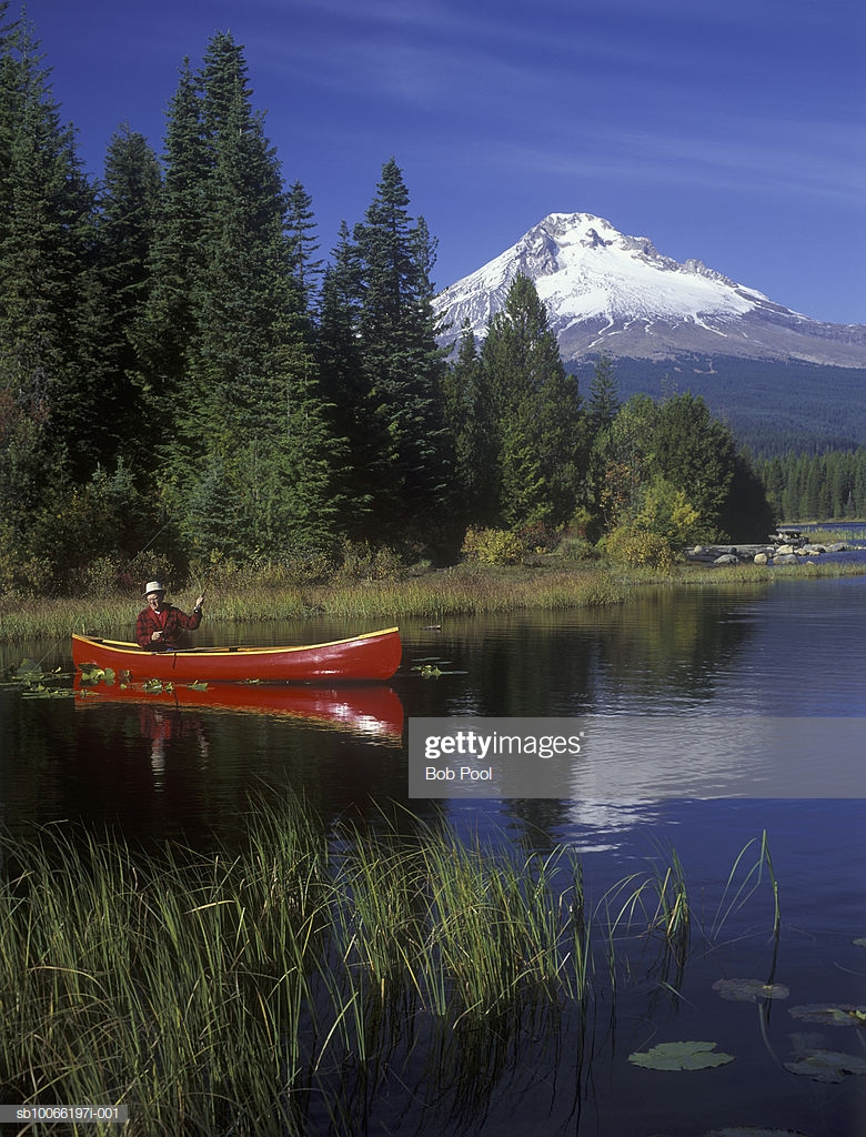 Man Fly Fishing From Red Canoe Mt Hood In Background High Res 780x1024
