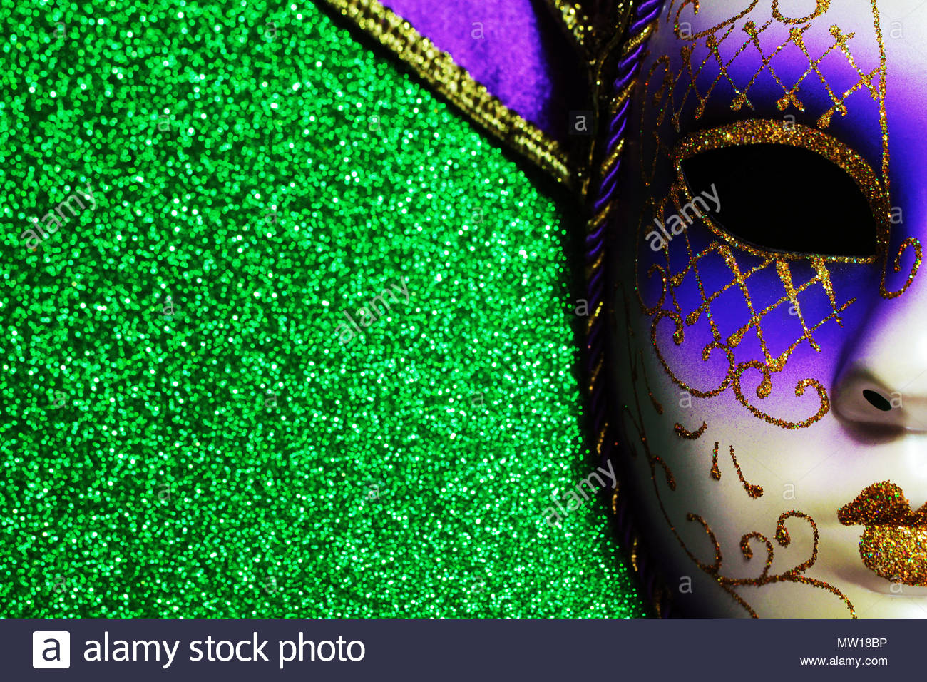 Background for Mardi gras or Fat tuesday with masquerade mask 1300x956