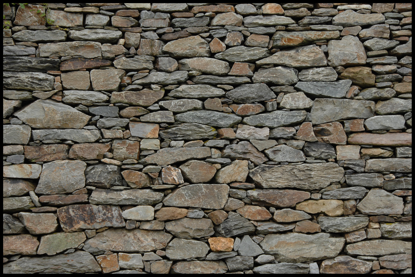 Wallpaper stone wall wallpapersafari for Wallpaper on home walls