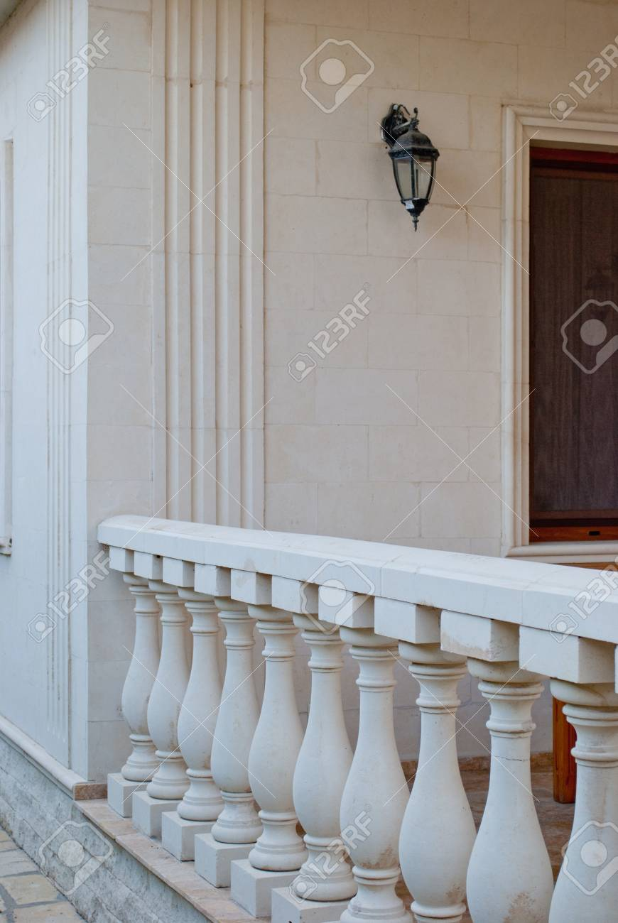 White Marble Columns In A Row Parapet Fence Against A 870x1300