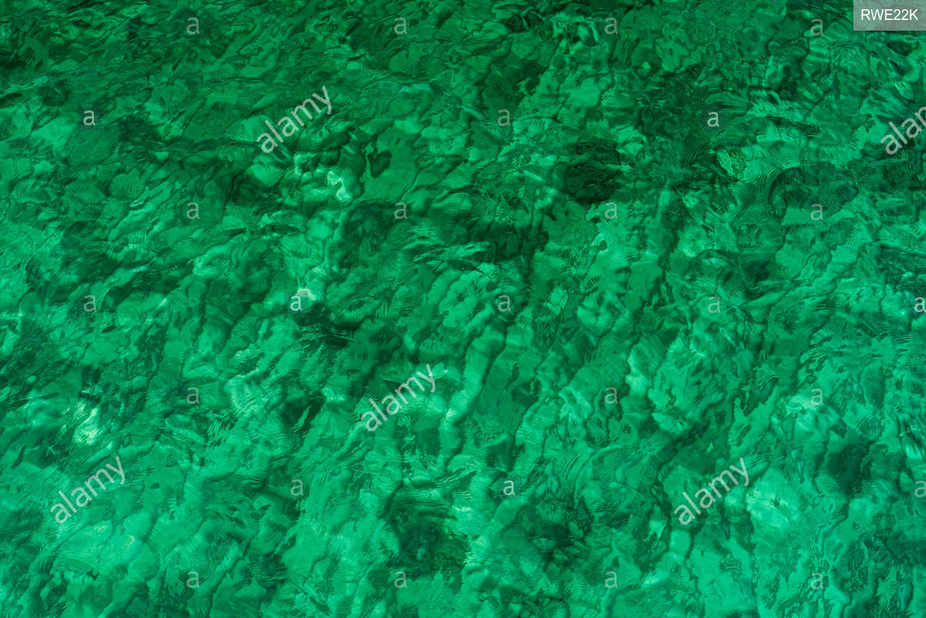 Green abstract texture background of emerald green sea water Top 1300x867