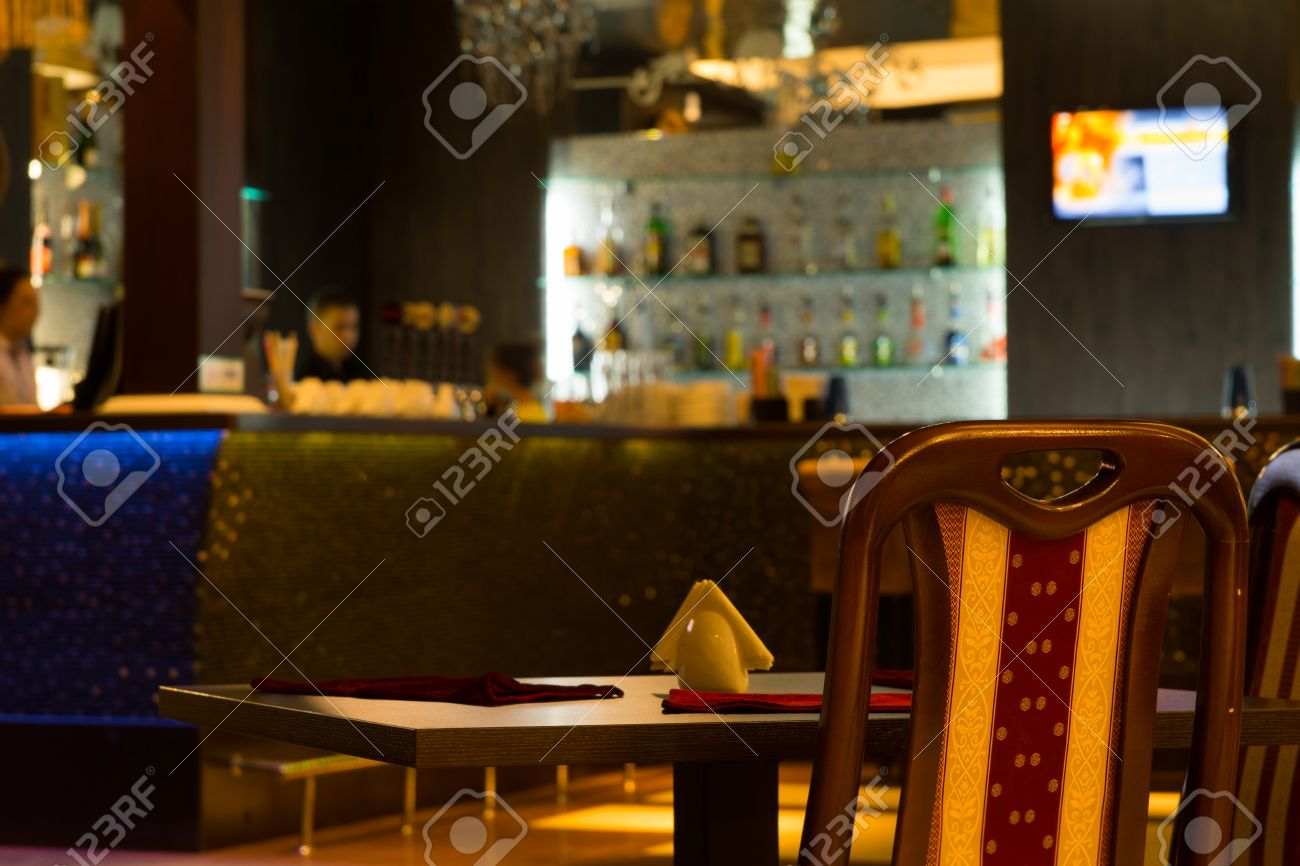 Empty Table In Barroom With Blurred Background Stock Photo 1300x866
