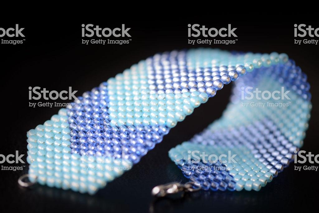 Blue Peyote Bracelet On A Dark Background Close Up Stock Photo 1024x684