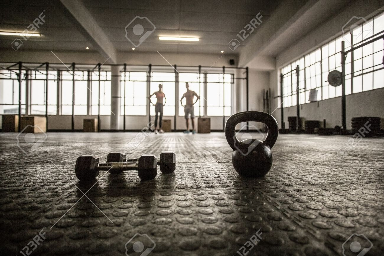 Two Fit People On The Background In Crossfit Gym Stock Photo 1300x866