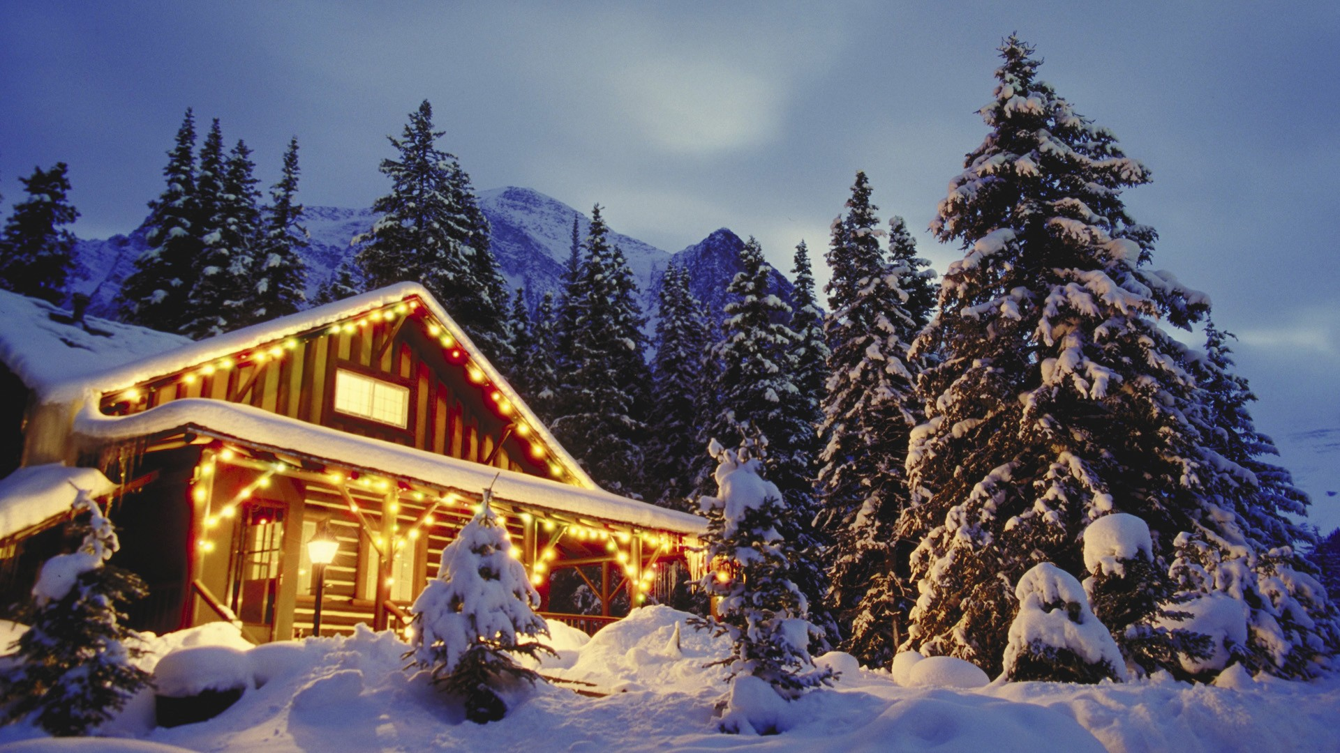 Wooden cabins in the snowy mountains wallpaper Wallpaper Wide HD 1920x1080