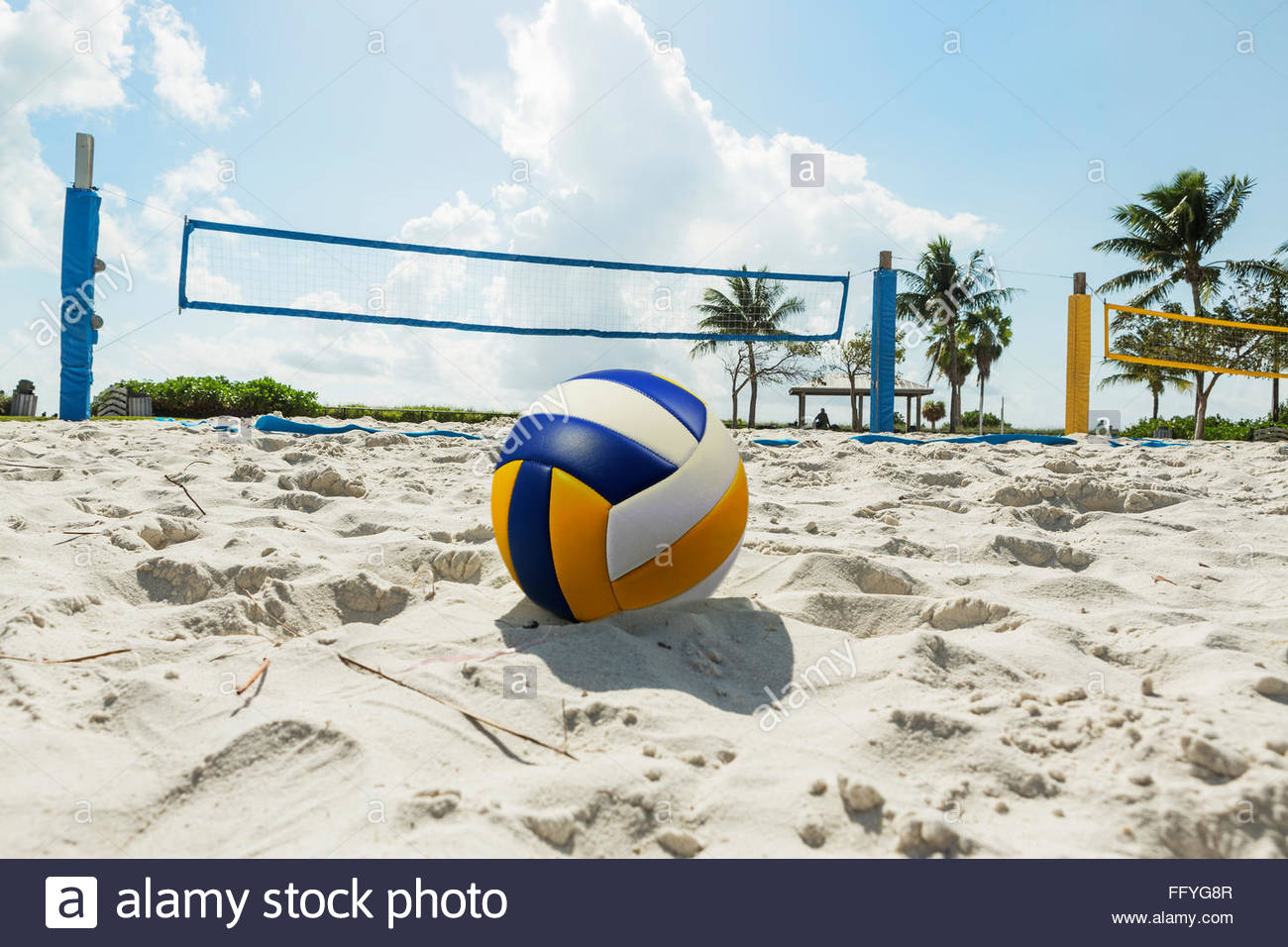 Volley ball in the foreground on the sand beach in the background 1300x956