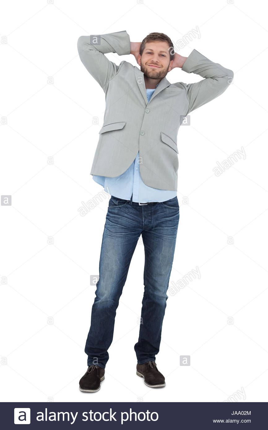 Suave man in a blazer with hands behind head looking at camera on 866x1390