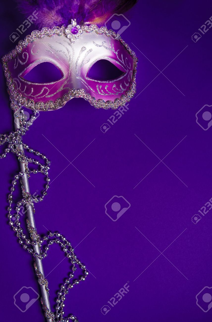 A Purple Mardi Gras Mask On A Purple Background With Beads 856x1300