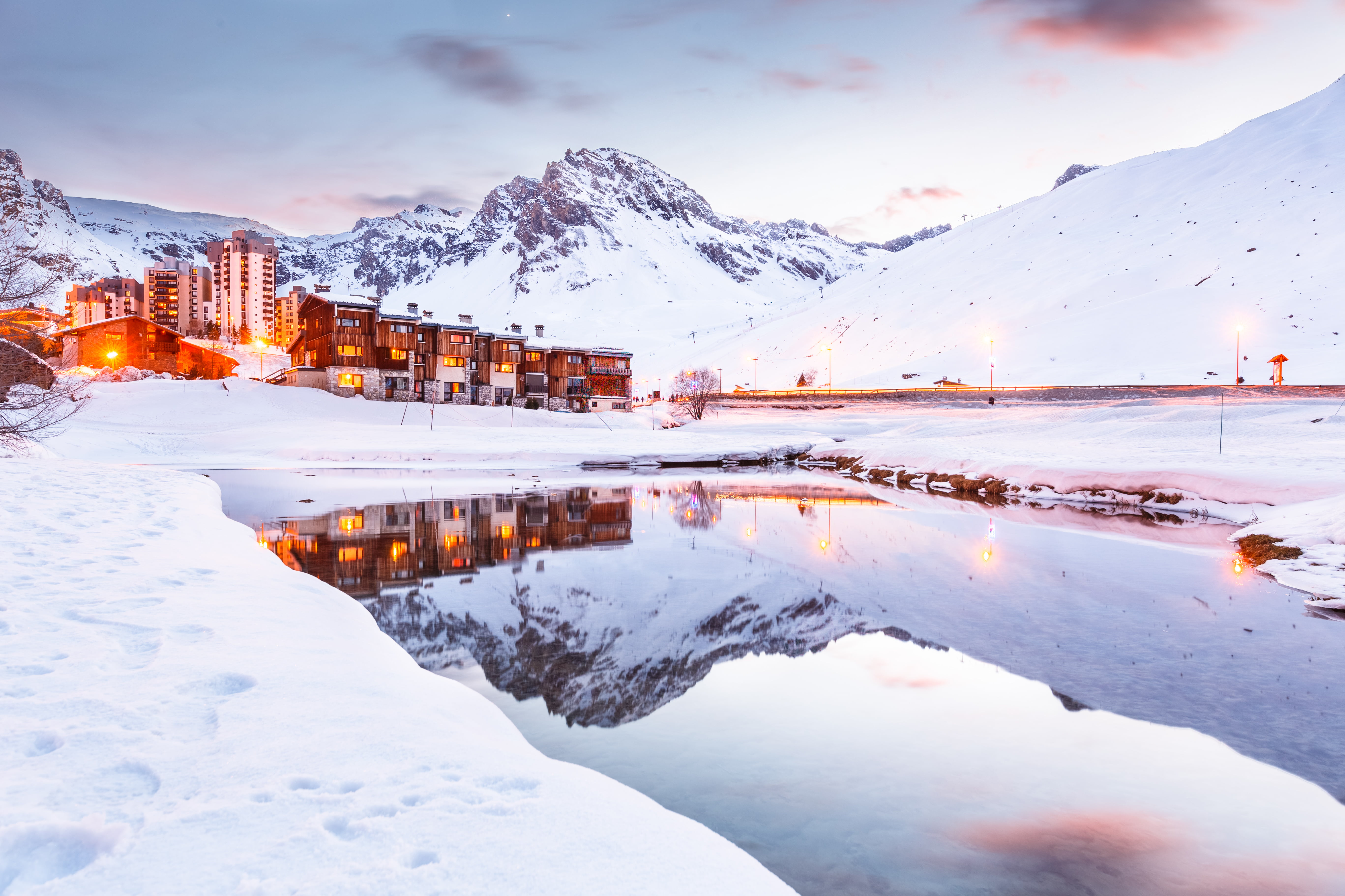 Brown and white building during winter mirror lake tignes HD 5471x3647