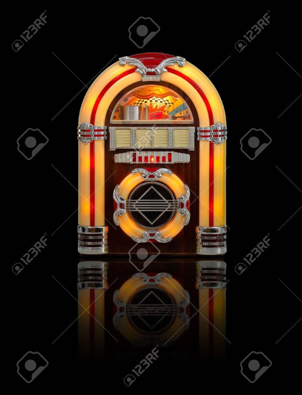 Retro Jukebox Radio Isolated On Black Background With Reflection 994x1300