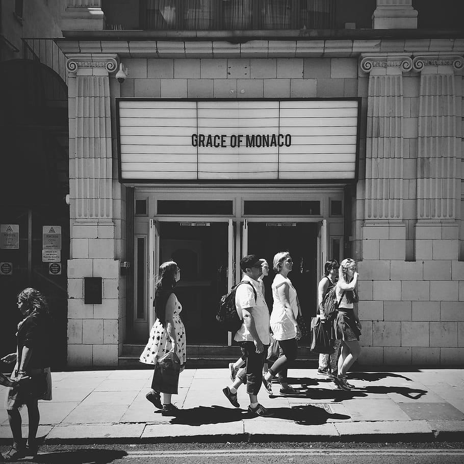 HD wallpaper grayscale photo of people walking on sidewalk 910x910