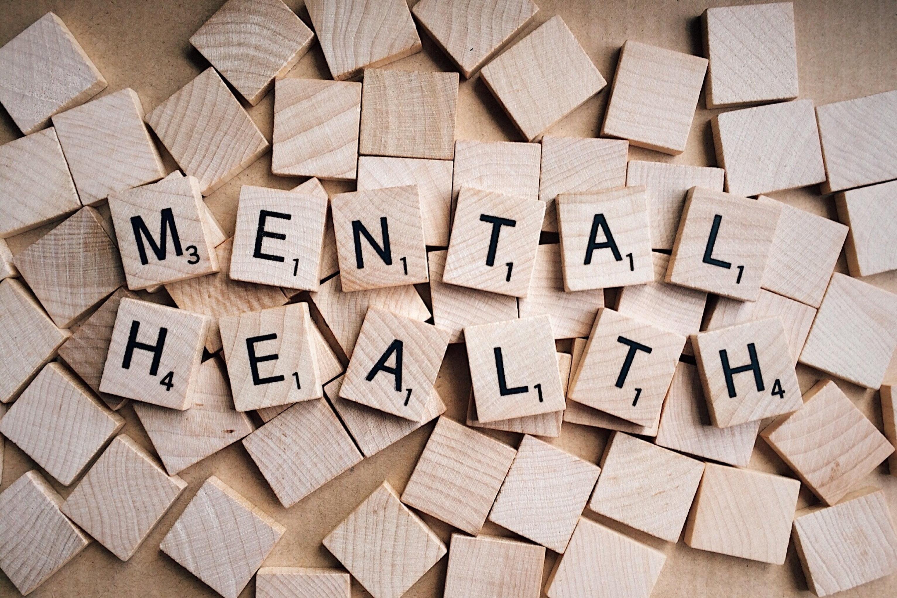 Scrabble tiles spelling mental health text above scrabble tiles 3065x2043