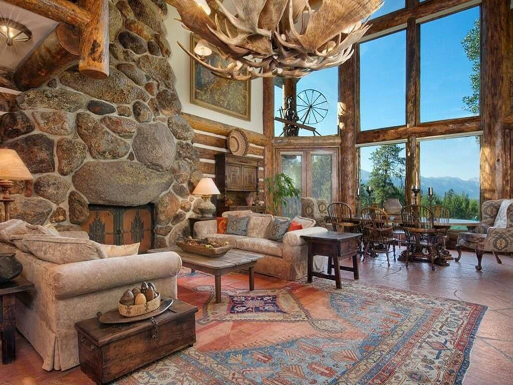 Massive living room done in log cabin style with rough exposed beams 1024x768