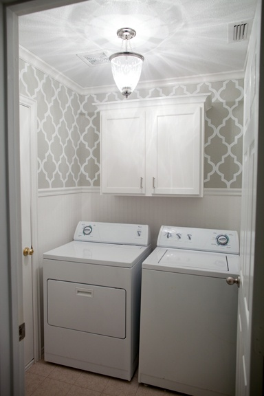 Grey stenciled laundry room with wallpaper wainscoting The after 384x576