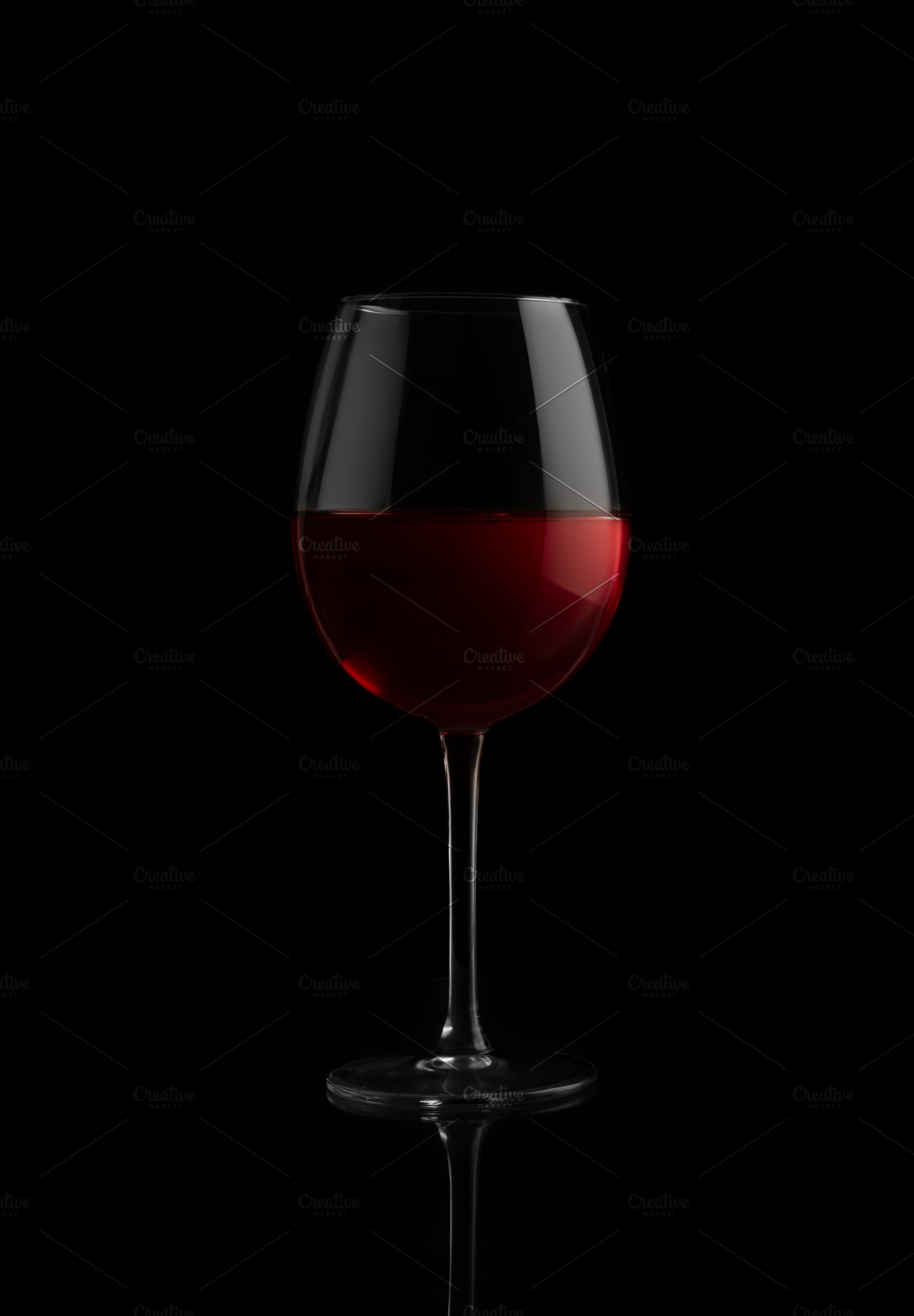 Red wine glass on a black background High Quality Food Images 1820x2620