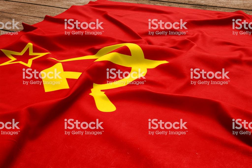 Flag Of Soviet Union On A Wooden Desk Background Silk Soviet Flag 1024x683