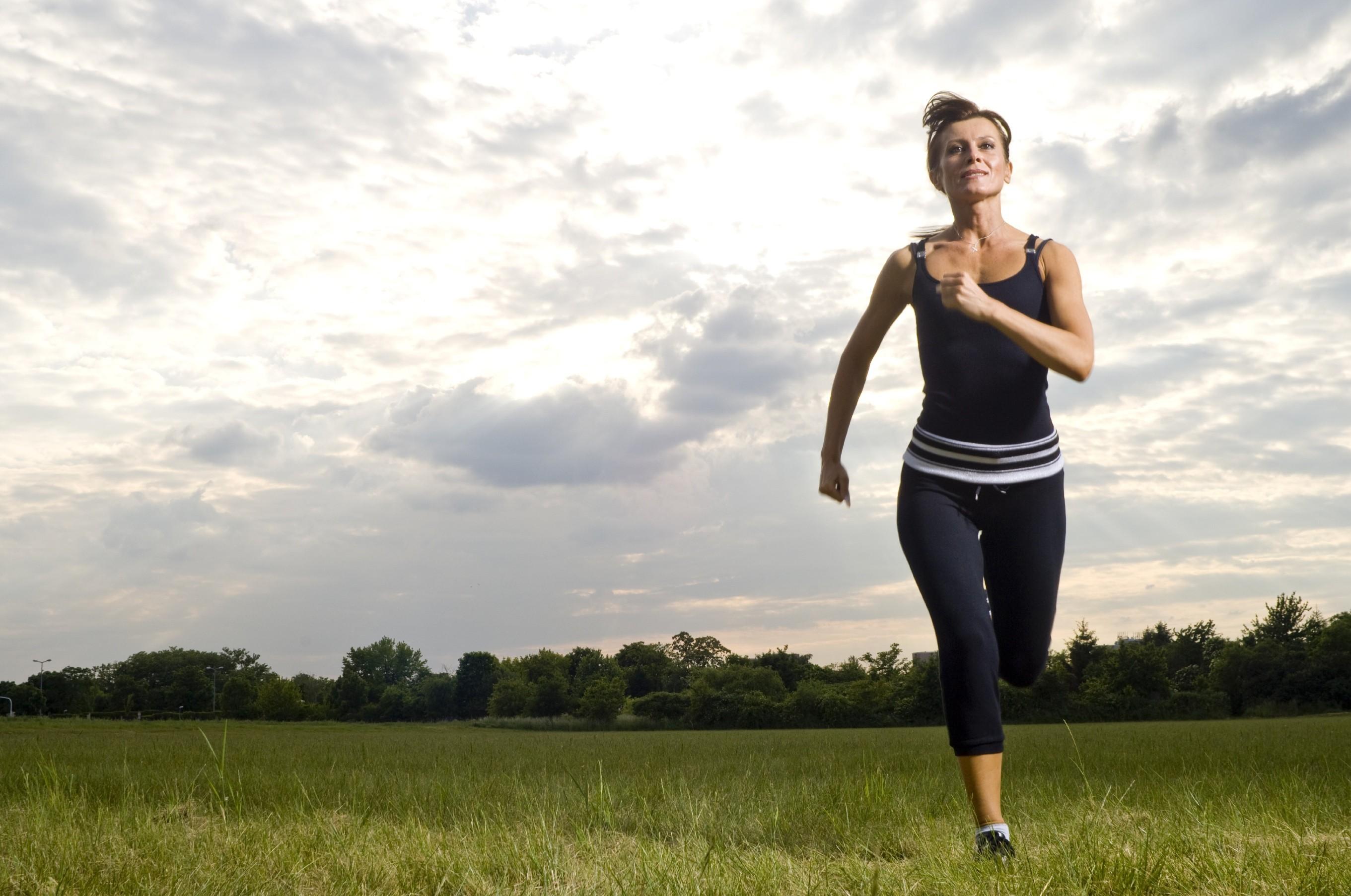 A Woman Joggin in the Open Field HD Health Wallpaper   Wallpaper 2721x1806