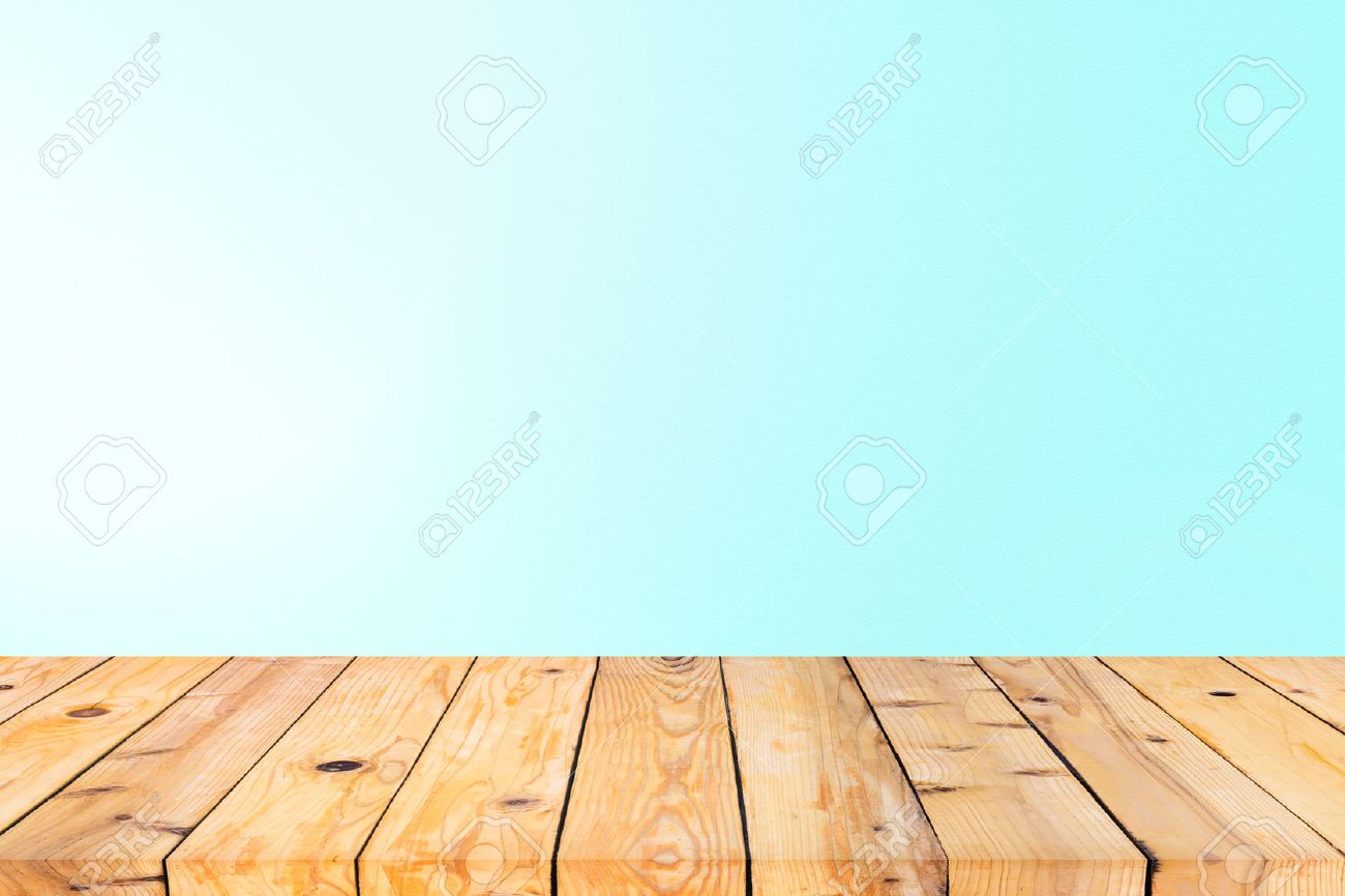 Wood Table Top On Blue Wall Background Stock Photo Picture And 1300x866