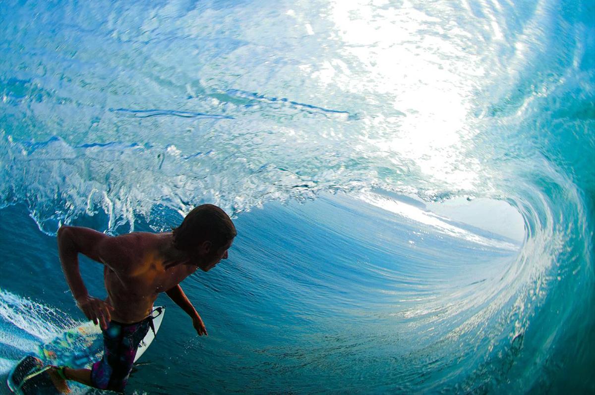surfers surfing 1200x797