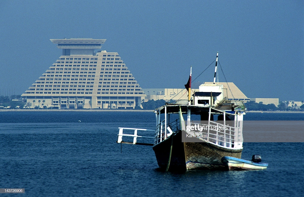 A Dhow At The Doha Corniche With The Sheraton Hotel In The 1024x662
