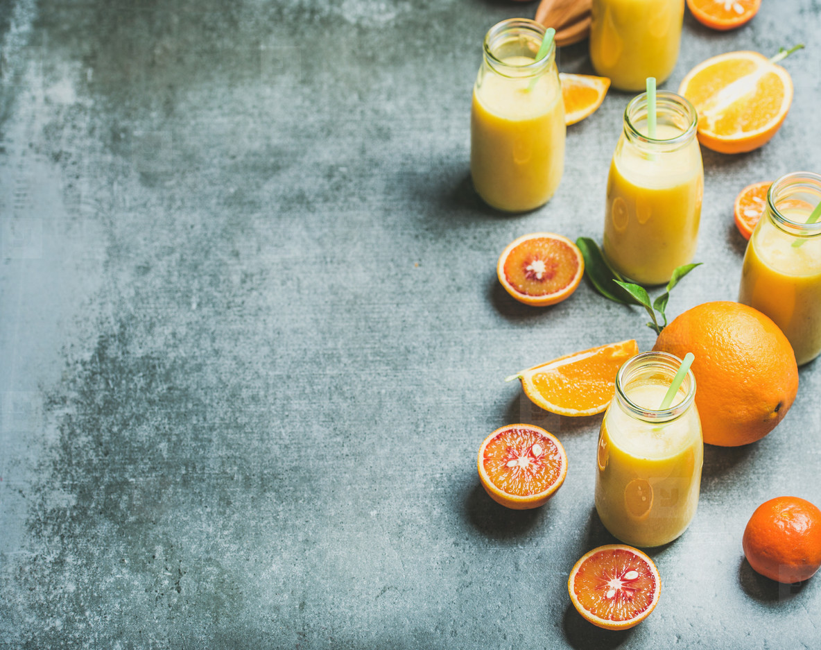 Photos   Healthy yellow smoothie in bottles over concrete 1184x937
