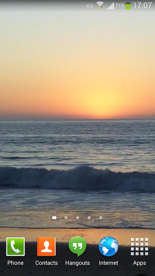 Ocean Live Wallpaper at sunset with some gentle blue ocean waves 506x900