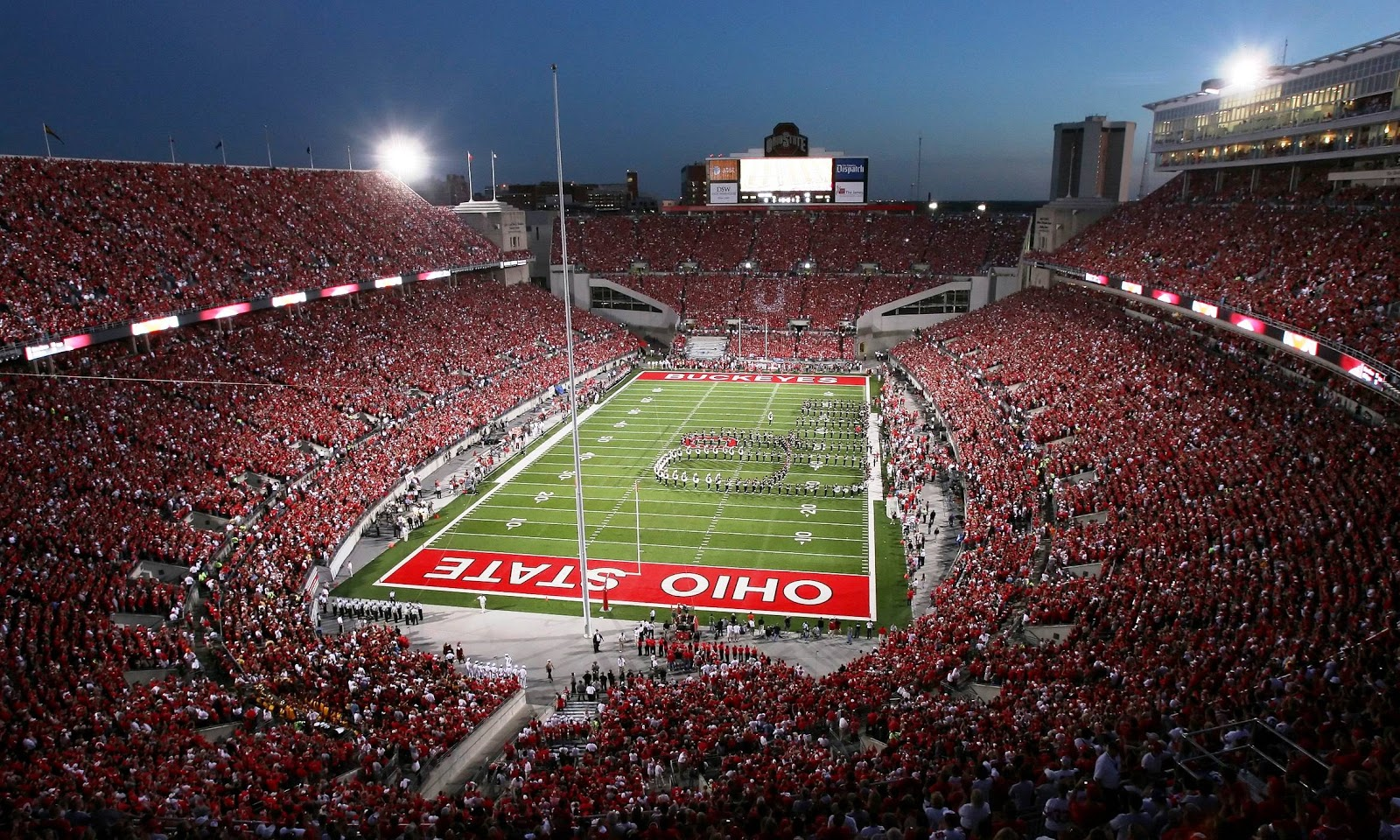 the ohio state buckeyes football team is a collegiate football team 1600x960