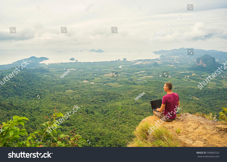 Man Working Laptop Sitting On Rocky Stock Photo Edit Now 590883323 1500x1074