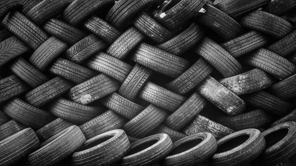 bunch of tires photo Pattern Image on Unsplash 1000x563