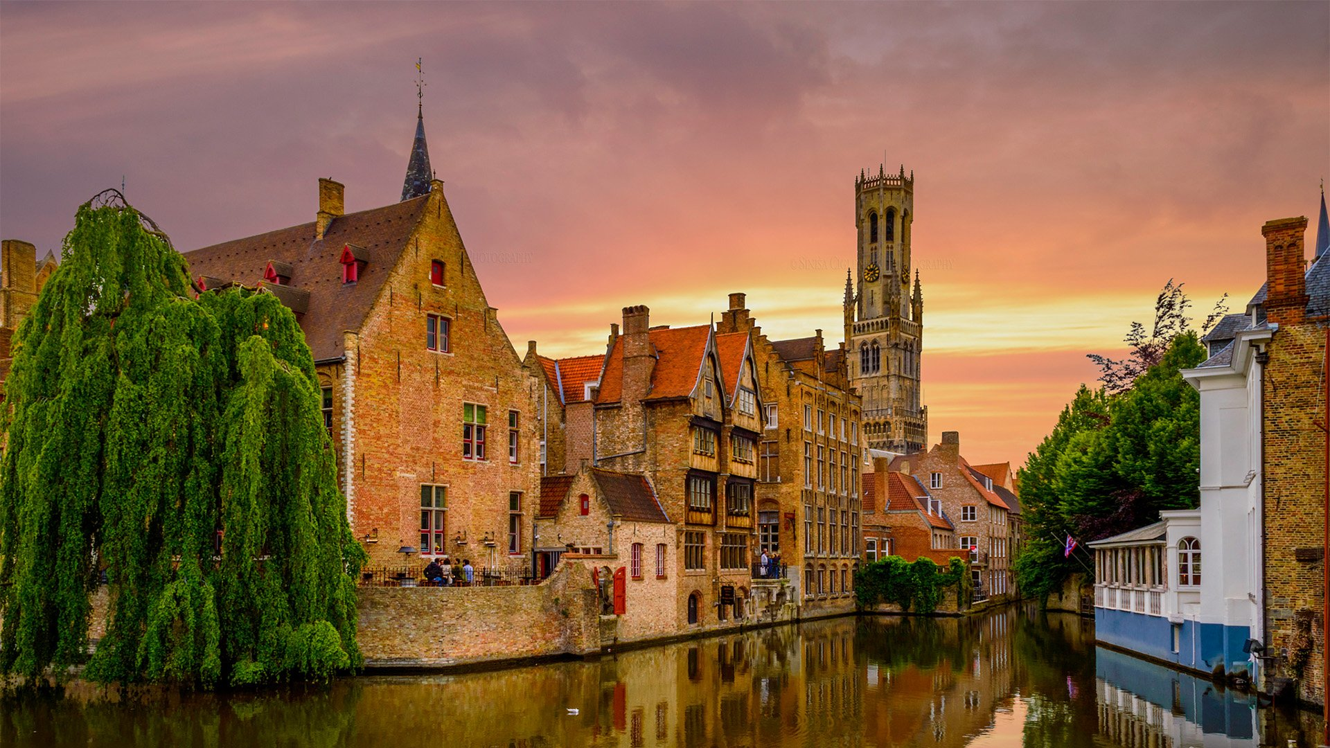 Buildings and Church along a Canal in Bruges Belgium HD Wallpaper 1920x1080