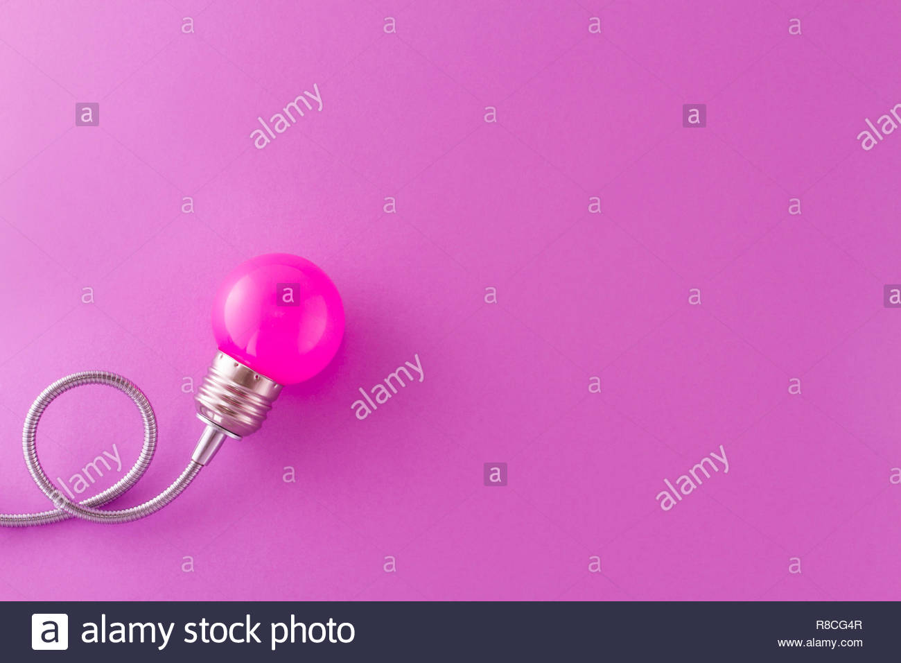 One pink decorative lamp on a light violet background and 1300x956